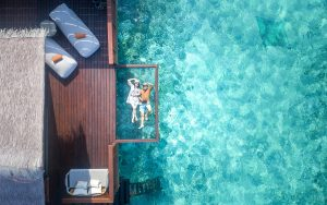 Couple Maldives Aerial Topdown Cover
